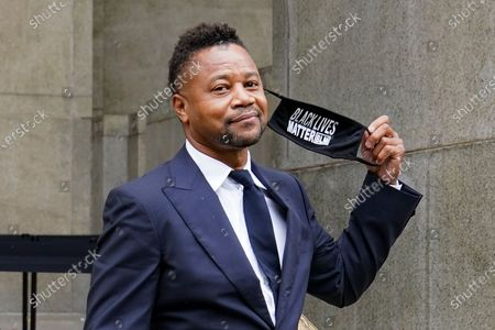 Stock Image of Cuba Gooding Jr. leaves court after a hearing in his sexual misconduct case, in New York. A judge ordered the courtroom outfitted with Plexiglas and other measures to prevent the spread of the coronavirus, which has delayed the trial indefinitely