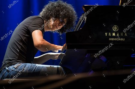 Stock Picture of Giovanni Allevi performs on stage with piano solo tour.