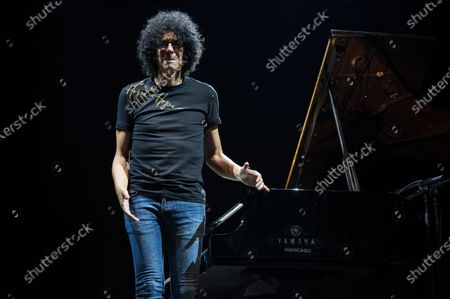 Giovanni Allevi performs on stage with piano solo tour.