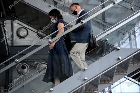 Green Party Chairwoman Annalena Baerbock (L) and Werner Baumann (R), CEO of German pharmaceutical company Bayer, walk down stairs at German pharmaceutical company Bayer in Leverkusen, Germany, 13 August 2020. Baerbock finds out about the short- and long-term production changes due to the coronavirus pandemic as well as preventive strategies against a shortage of medicines.