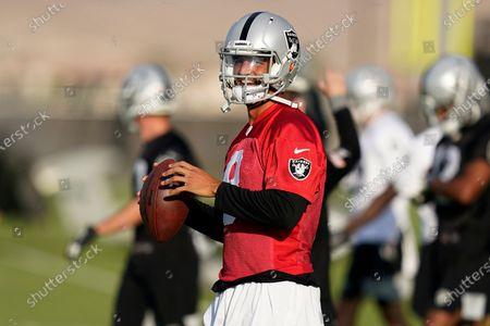 Las Vegas Raiders quarterback Marcus Mariota (8) prepares to throw during an NFL football training camp practice, in Henderson, Nev