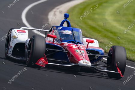 Tony Kanaan, of Brazil, drives through the third turn during practice for the Indianapolis 500 auto race at Indianapolis Motor Speedway in Indianapolis