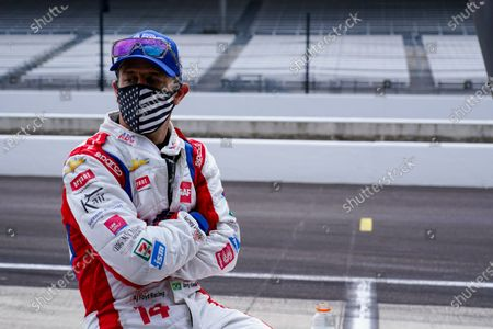 Tony Kanaan, of Brazil, watches from the pit area during practice for the Indianapolis 500 auto race at Indianapolis Motor Speedway in Indianapolis