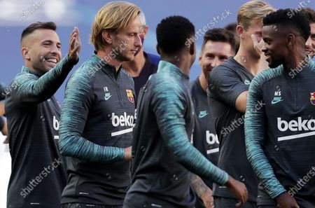 Jordi Alba (L) and Ivan Rakitic (2L) during the training session of Barcelona in Lisbon, Portugal, 13 August 2020. Barcelona will face Bayern Munich in an UEFA Champions League quarter final match on 14 August in Lisbon.