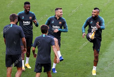 Arturo Vidal (R) and Jordi Alba (C) during the training session of Barcelona in Lisbon, Portugal, 13 August 2020. Barcelona will face Bayern Munich in an UEFA Champions League quarter final match on 14 August in Lisbon.
