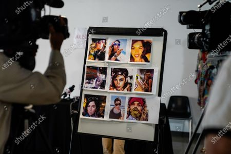 Photographs of the late Elizabeth Baggett are seen taped to a board before Attorney Gloria Allred speaks at a press conference on Tuesday, Aug. 11, 2020 in Los Angeles, CA. Allred's film, Allred, Maroko & Goldberg, filed the lawsuit on behalf of the estate of Elizabeth Baggett, whose dead body was allegedly fondled by an on-duty Los Angeles Police Department officer. (Kent Nishimura / Los Angeles Times)