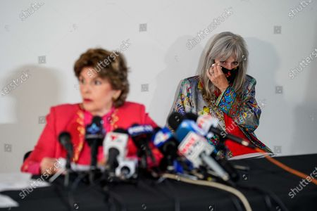 Janet Baggett, mother of the late Elizabeth Baggett, wipes her eyes as Attorney Gloria Allred speaks at a press conference on Tuesday, Aug. 11, 2020 in Los Angeles, CA. Allred's film, Allred, Maroko & Goldberg, filed the lawsuit on behalf of the estate of Elizabeth Baggett, whose dead body was allegedly fondled by an on-duty Los Angeles Police Department officer. (Kent Nishimura / Los Angeles Times)