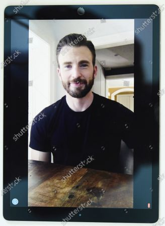"""Chris Evans, co-founder of the civic engagement video-based app """"A Starting Point"""" with Mark Kassen, is photographed on a tablet during a remote portrait session with photographer in Los Angeles and subject in Boston, Mass"""