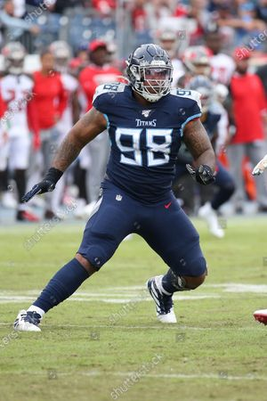 Tennessee Titans defensive tackle Jeffery Simmons (98) plays during an NFL football game against the Tampa Bay Buccaneers in Nashville, Tenn. Simmons, DaQuan Jones and Harold Landry are ready for the challenge of filling the hole left by Tennessee trading five-time Pro Bowl defensive lineman Jurrell Casey to Denver in March