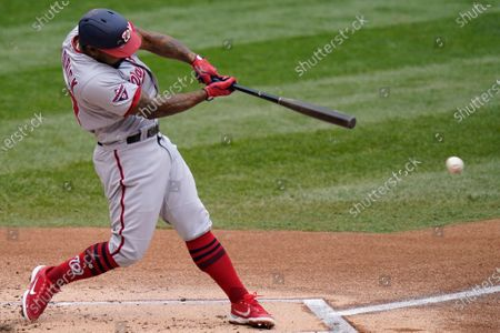 Washington Nationals' Howie Kendrick drives in a run during the first inning of a baseball game against the New York Mets at Citi Field, in New York