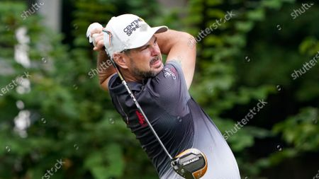Rory Sabbatini, of South Africa, drives on the eighth hole during the first round of the Wyndham Championship golf tournament at Sedgefield Country Club, in Greensboro, N.C