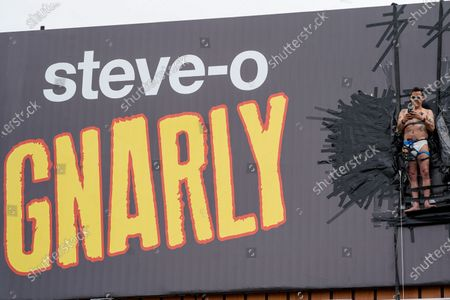 """Actor Steve-O is seen taped to a Hollywood billboard along Cahuenga Boulevard on Thursday, Aug. 13, 2020 in Los Angeles, CA. Steve-O, the star from MTV's Jackass series, is promoting his new project, """"Gnarly."""" (Kent Nishimura / Los Angeles Times)"""