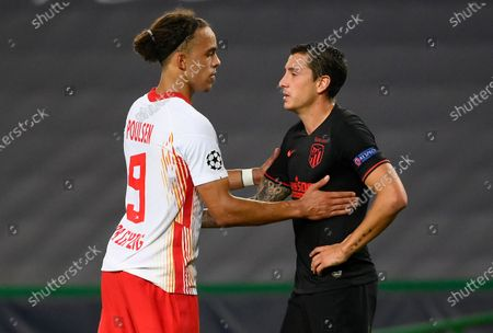 Stock Image of Leipzig's Yussuf Poulsen consoles Atletico Madrid's Sime Vrsaljko, right, after the Champions League quarterfinal match between RB Leipzig and Atletico Madrid at the Jose Alvalade stadium in Lisbon, Portugal