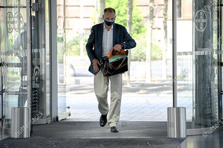 Werner Baumann, CEO of German pharmaceutical company Bayer AG, wears a face mask as he leaves the company's headquarters in Leverkusen, Germany, 13 August 2020. While management is making progress in resolving the multi-billion dollar litigation over alleged cancer risks of glyphosate-containing weed killers, the Corona pandemic is now causing a jolt in day-to-day operations. At the same time, the agrochemical and pharmaceutical company is pressing ahead rapidly with the integration of the seed and crop protection group Monsanto, which was acquired in 2018, and is also generating new growth impetus in the pharmaceuticals business.
