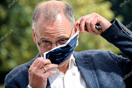 Stock Picture of Werner Baumann, CEO of German pharmaceutical company Bayer AG, puts on a face mask at the company's headquarters in Leverkusen, Germany, 13 August 2020. While management is making progress in resolving the multi-billion dollar litigation over alleged cancer risks of glyphosate-containing weed killers, the Corona pandemic is now causing a jolt in day-to-day operations. At the same time, the agrochemical and pharmaceutical company is pressing ahead rapidly with the integration of the seed and crop protection group Monsanto, which was acquired in 2018, and is also generating new growth impetus in the pharmaceuticals business.