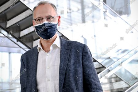 Stock Image of Werner Baumann, CEO of German pharmaceutical company Bayer AG, wears a face mask as he leaves the company's headquarters in Leverkusen, Germany, 13 August 2020. While management is making progress in resolving the multi-billion dollar litigation over alleged cancer risks of glyphosate-containing weed killers, the Corona pandemic is now causing a jolt in day-to-day operations. At the same time, the agrochemical and pharmaceutical company is pressing ahead rapidly with the integration of the seed and crop protection group Monsanto, which was acquired in 2018, and is also generating new growth impetus in the pharmaceuticals business.