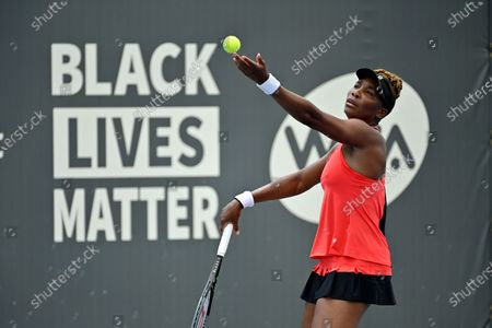 Venus Williams prepares to serve to her sister Serena Williams during the WTA tennis tournament in Nicholasville, Ky