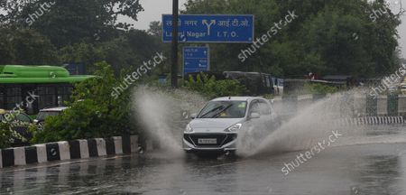 A car crosses a waterlogged stretch after heavy rain along Ring Road near Indira Gandhi stadium on August 13, 2020 in New Delhi, India.