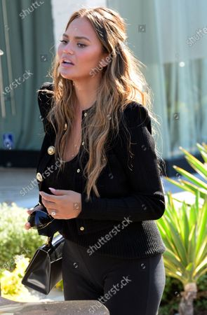 Chrissy Teigen, who today announced that she was pregnant is seen out in West Hollywood