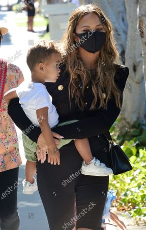 Chrissy Teigen, who today announced that she was pregnant is seen out in West Hollywood with son Miles