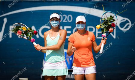 Stock Photo of Raluca Olaru & Monica Niculescu of Romania after the doubles final of the 2020 Prague Open WTA International tennis tournament