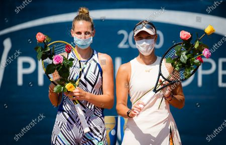 Lucie Hradecka & Kristyna Pliskova of the Czech Republic pose with their winners trophy after the doubles final of the 2020 Prague Open WTA International tennis tournament