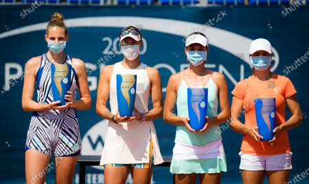 Lucie Hradecka & Kristyna Pliskova of the Czech Republic and Monica Niculescu & Raluca Olaru of Romania with their trophies after the doubles final of the 2020 Prague Open WTA International tennis tournament
