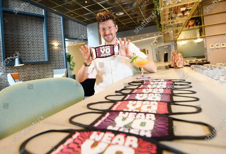 Stock Picture of Henry Holland launches his new face mask collection designed exclusively for YOTEL London - 'WEAR YO MASK!'  Henry Holland poses with his new Collection of facemasks at YOTEL in Clerkenwell