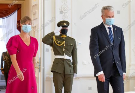 Estonia's President Kersti Kaljulaid, left, and Lithuania's President Gitanas Nauseda, wearing a face masks to protect against the coronavirus, walk together for their meeting at the President's palace in Vilnius, Lithuania