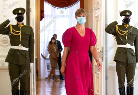 Estonia's President Kersti Kaljulaid wearing a face masks to protect against the coronavirus, arrives for a meting with Lithuania's President Gitanas Nauseda at the President's palace in Vilnius, Lithuania
