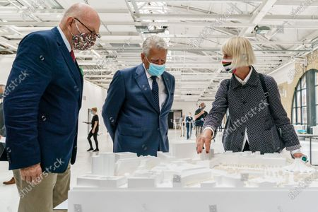 Former German President and patron of the Exilmuseum Joachim Gauck (C) wears a face mask as he talks to architect Jorunn Ragnarsdottir of the jury (R) next to founding director of the foundation Exilmuseum Christoph Stoelzl (L) as they look at a model of the winning draft by Dorte Mandrup office from Copenhagen prior to a press conference on the  architectural competition for the realization of a new Exilmuseum building in Berlin, Germany, 14 August 2020. The winning architectural draft for the new Exilmuseum comes from Dorte Mandrup office from Copenhagen.