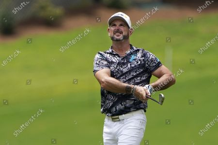 Rory Sabbatini, of South Africa, watches his shot from the rough on the 10th hole during the second round of the Wyndham Championship golf tournament at Sedgefield Country Club, in Greensboro, N.C
