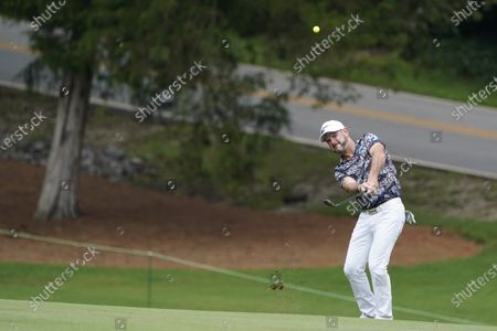 Rory Sabbatini, of South Africa, hits from the fairway on the 11th hole during the second round of the Wyndham Championship golf tournament at Sedgefield Country Club, in Greensboro, N.C