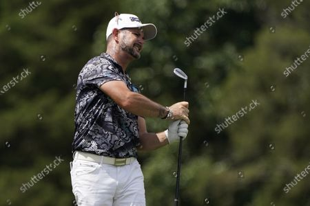 Rory Sabbatini, of South Africa, watches his shot on the 16th hole during the second round of the Wyndham Championship golf tournament at Sedgefield Country Club, in Greensboro, N.C