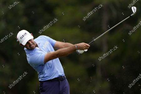 Charl Schwartzel, of South Africa, hits on the 16th hole during the second round of the Wyndham Championship golf tournament at Sedgefield Country Club, in Greensboro, N.C