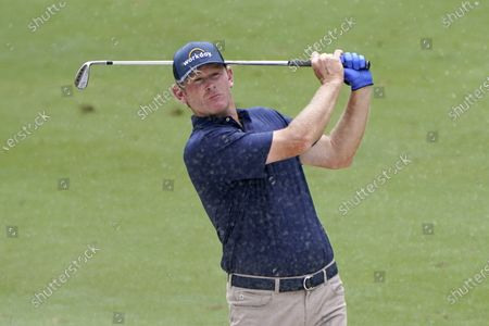 Brandt Snedeker watches his shot from a fairway bunker on the ninth hole during the second round of the Wyndham Championship golf tournament at Sedgefield Country Club, in Greensboro, N.C