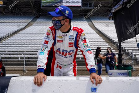 Tony Kanaan, of Brazil, looks down the pit lane during practice for the Indianapolis 500 auto race at Indianapolis Motor Speedway in Indianapolis