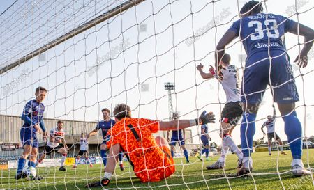 Stock Image of Dundalk vs Waterford. Waterford's goalkeeper Tadhg Ryan is unable to save Daniel Cleary of Dundalk (not pictured) goal