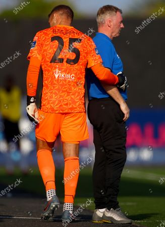 Stock Image of Dundalk vs Waterford. Waterford goalkeeper Brian Murphy goes of injured as manager John Sheridan looks on