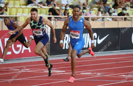 Stock Picture of Spain's Orlando Ortega, right, crosses the line to win the men's 110 hurdles next to second placed Britain's Andrew Pozzi, left, during the Diamond League athletics meeting at the Louis II stadium in Monaco