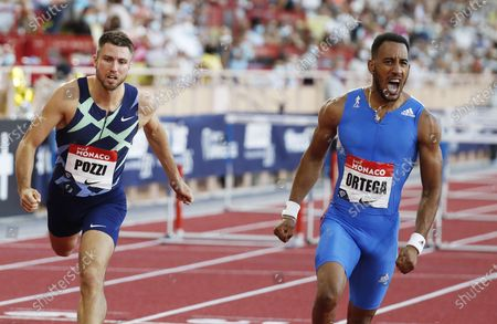 Orlando Ortega of Spain celebrates winning the 110m Hurdles race at the World Athletics Diamond League meeting in Monaco, 14 August 2020. Left is Andrew Pozzi of Great Britain who placed second.