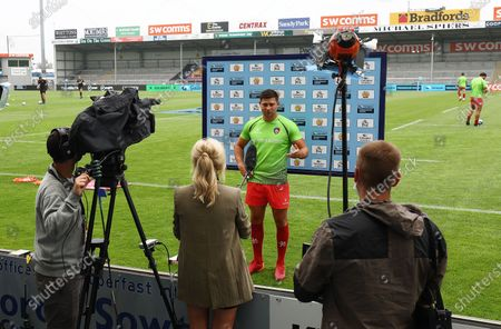 Ben Youngs of Leicester Tigers is interviewed before the match.
