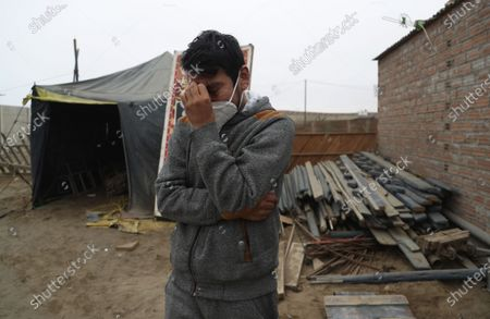 """Circus clown Julio Cesar Chiroque, 38, whose clown name is """"Galleta,"""" or Cookie, tears up as he explains his family's dire economic situation brought by the economic shutdown to curb the spread of COVID-19 outside his home in a poor neighborhood on the outskirts of Lima, Peru, . Chiroque's family used to run their own small circus, but since March when the lockdown to curb COVID-19 closed their business, and the requirement for seniors over 60 to self-quarantine kept his father home-bound, they started selling circus food like caramelized apples to survive"""