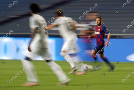 Barcelona's Jordi Alba, right, controls the ball during the Champions League quarterfinal match between FC Barcelona and Bayern Munich at the Luz stadium in Lisbon, Portugal