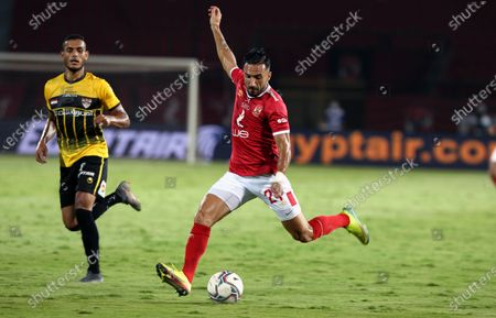 Al-Ahly player Ali Maaloul (R) in action during the Egyptian Premier League soccer match between Al Entag Al Harby and Al-Ahly, in Cairo, Egypt, 14 August 2020.