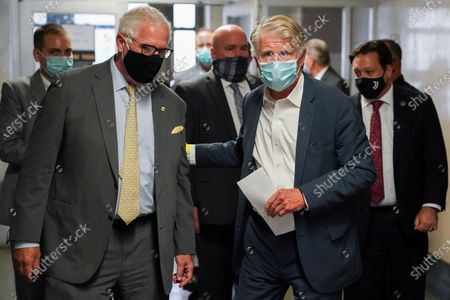 Manhattan District Attorney Cyrus Vance Jr., right, and John Miller, NYPD Deputy Commissioner of Intelligence & Counterterrorism, left, leave court after a hearing in the case against Abdullah al-Faisal, in New York