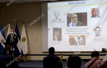 The head of the Special Anti-Corruption Unit of the Attorney General's Office of El Salvador, German Arriaza (L), exposes the accusation against former President Mauricio Funes (2009-2014) and five other people for the alleged embezzlement and laundering of more than 45.2 million dollars from the construction of a dam, during a press conference, in San Salvador, El Salvador, 14 August 2020. The Salvadoran Prosecutor's Office charged Funes and the other five implicated by this fact.
