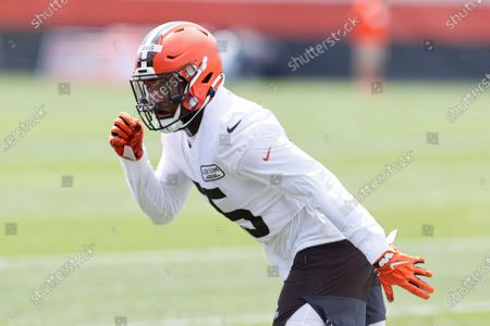 Cleveland Browns linebacker Tae Davis runs through a drill during practice at the NFL football team's training facility, in Berea, Ohio