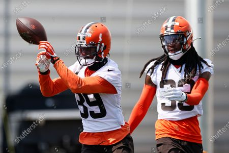 Cleveland Browns cornerback Terrance Mitchell (39) runs through a drill against Donovan Olumba #33 during practice at the NFL football team's training facility, in Berea, Ohio