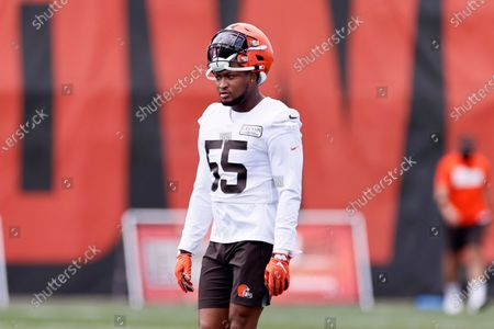 Cleveland Browns linebacker Tae Davis walks onto the field during practice at the NFL football team's training facility, in Berea, Ohio